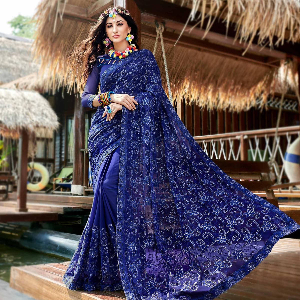 Amazing Blue Colored Partywear Embroidered Georgette Saree