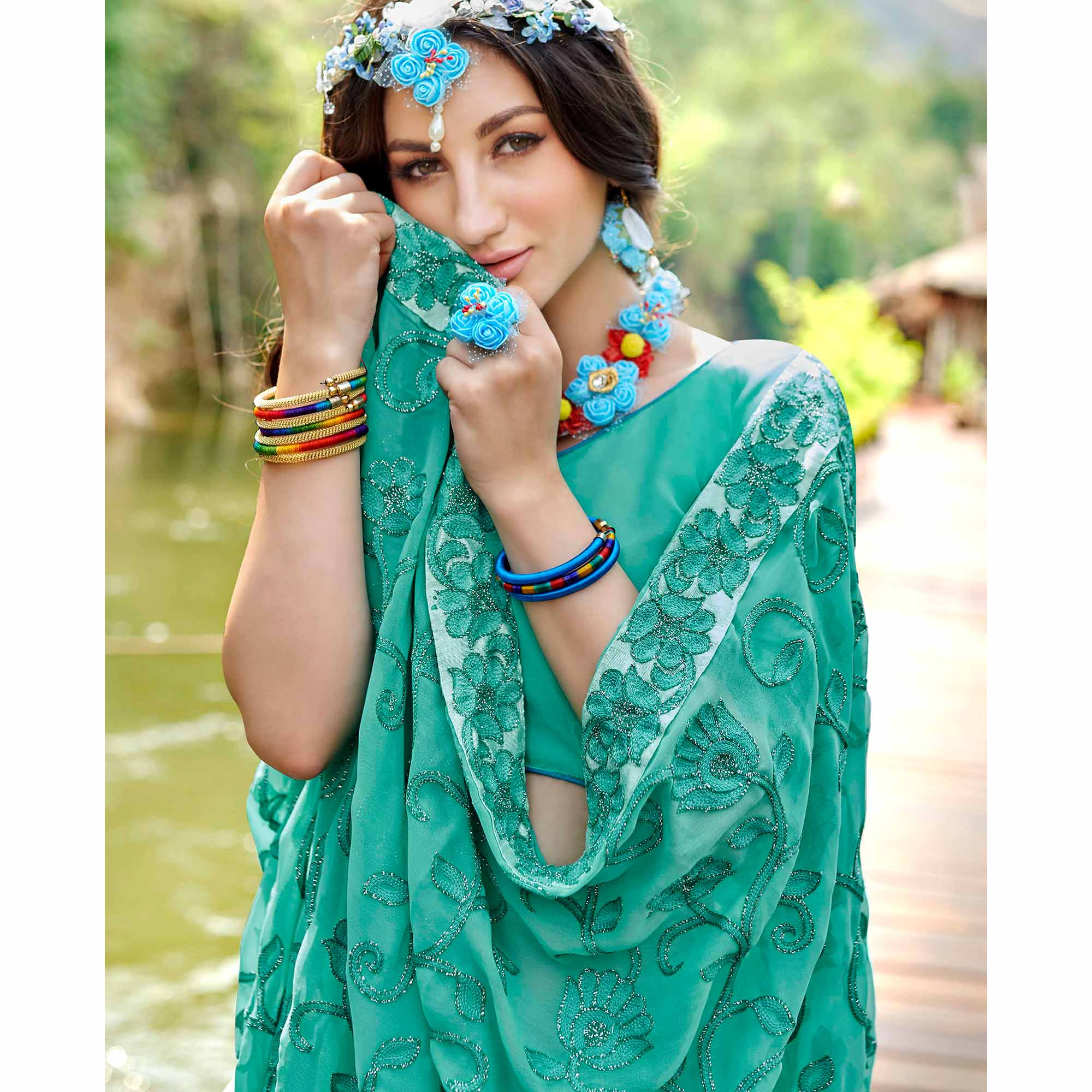 Gorgeous Aqua Green Colored Partywear Embroidered Georgette Saree