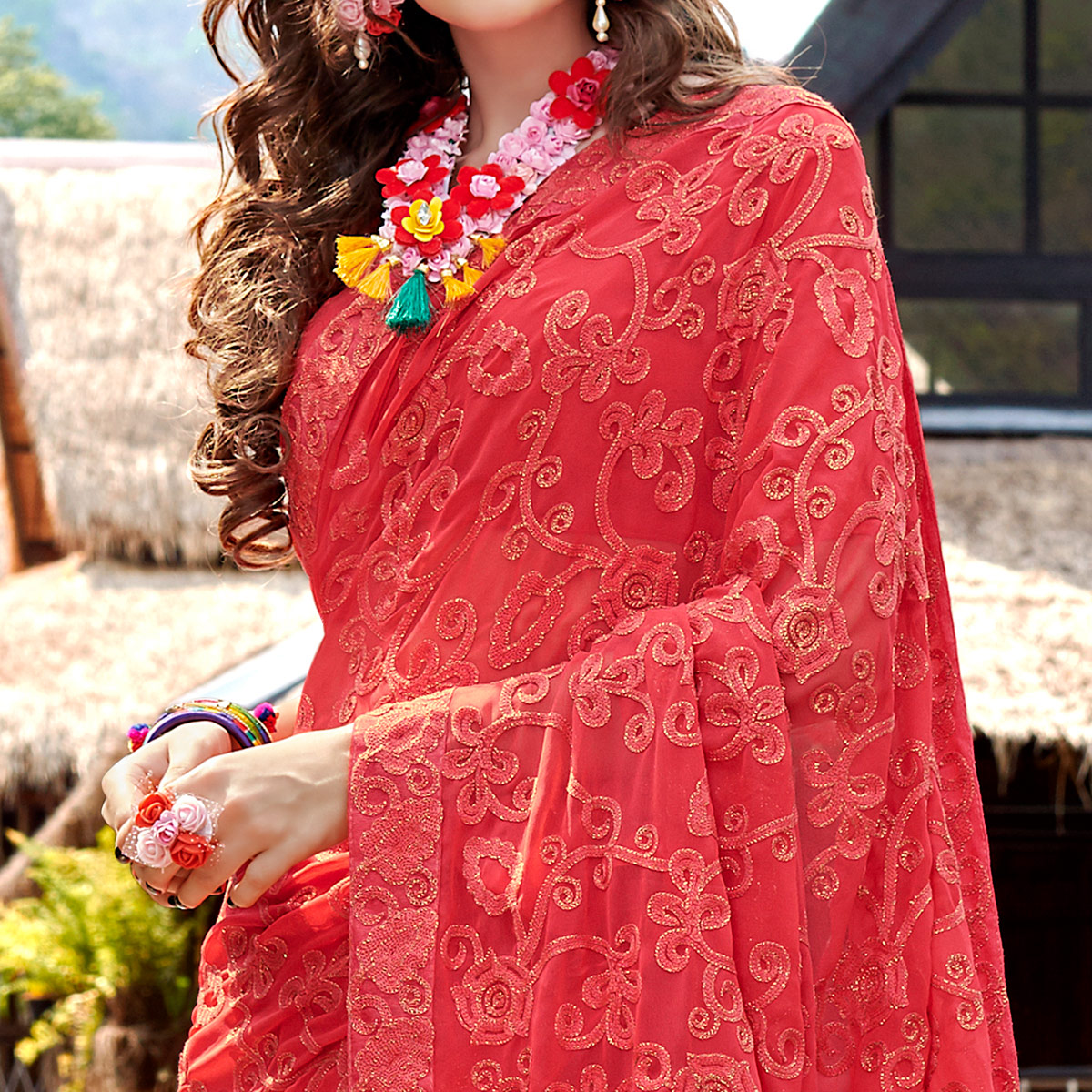 Imposing Coral Red Colored Partywear Embroidered Georgette Saree