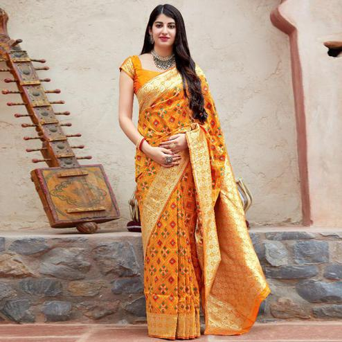 Impressive Orange Colored Festive Wear Woven Banarasi Patola Silk Saree