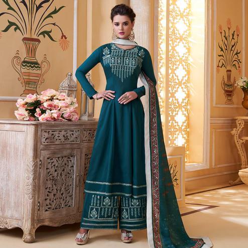 Adorable Teal Blue Colored Partywear Embroidered Muslin Palazzo Suit