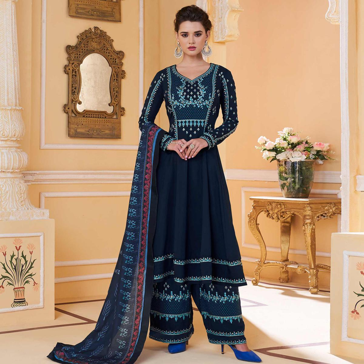 Graceful Navy Blue Colored Partywear Embroidered Muslin Palazzo Suit