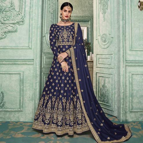 Demanding Navy Blue Colored Partywear Embroidered Silk Anarkali Suit