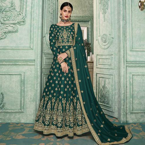 Magnetic Teal Green Colored Partywear Embroidered Silk Anarkali Suit