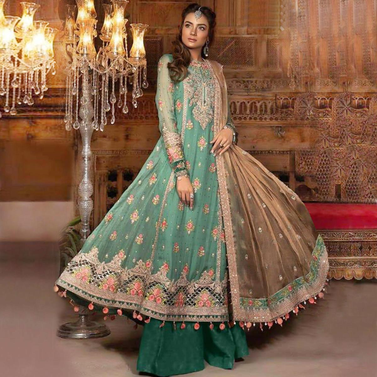 Entrancing Aqua Green Colored Partywear Embroidered Netted Palazzo Suit