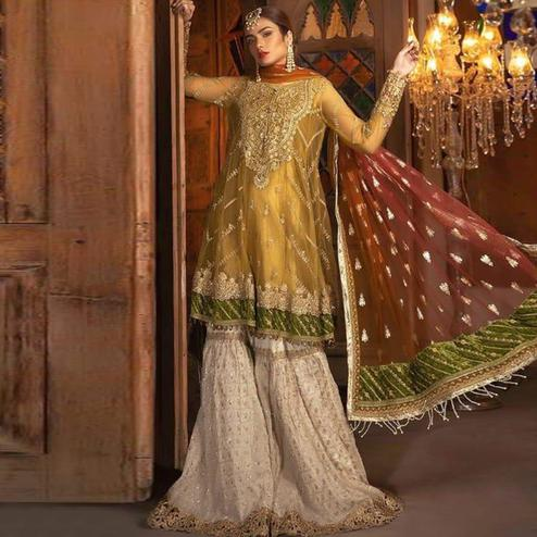 Prominent Mustard Yellow Colored Partywear Embroidered Netted Palazzo Suit