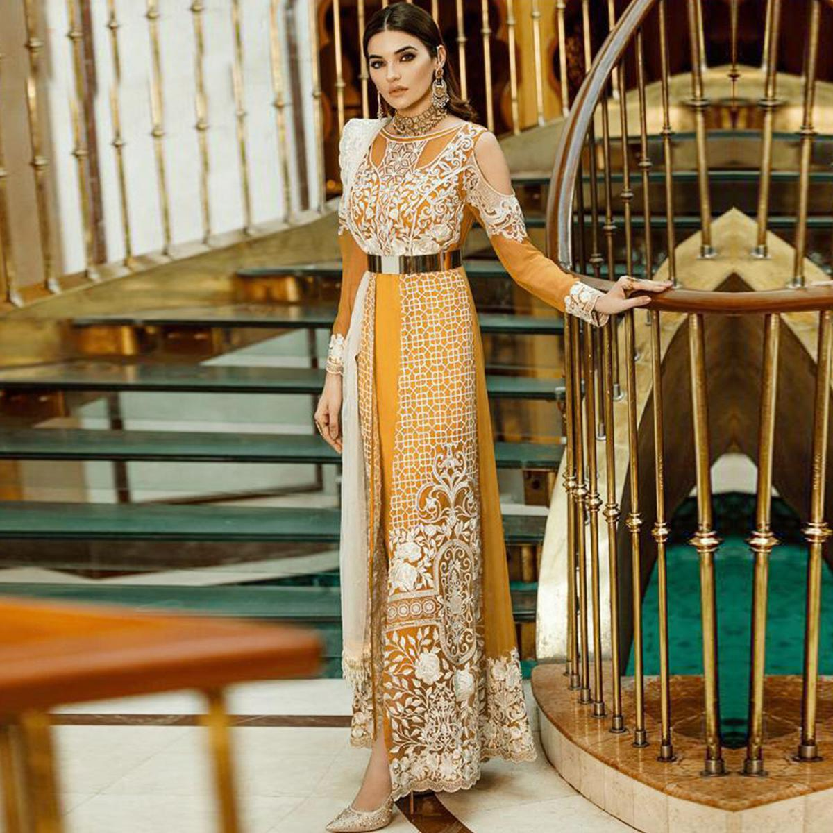 Graceful Mustard Yellow Colored Partywear Embroidered Georgette-Net Pant Style Suit