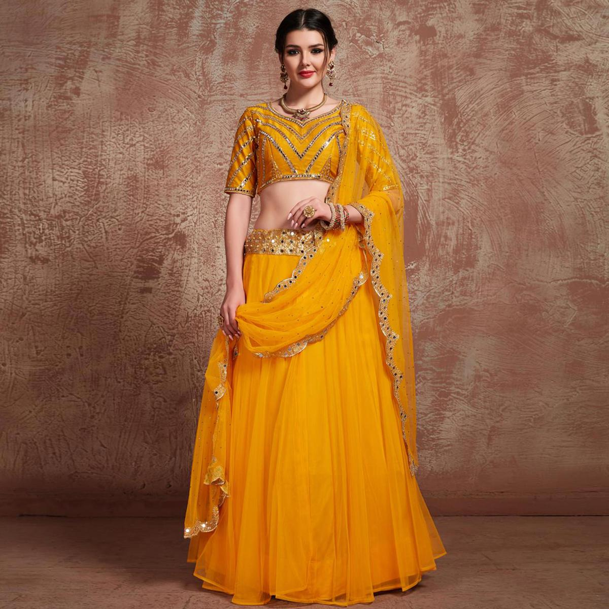 Flamboyant Yellow Colored Partywear Embroidered Soft Net Lehenga Choli