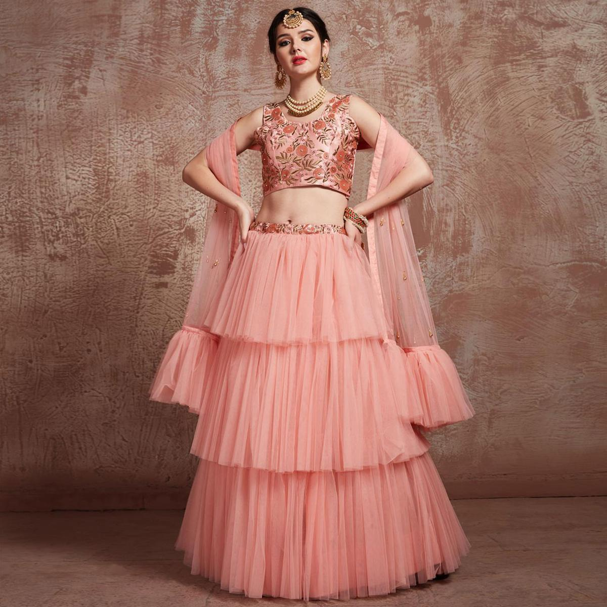 Marvellous Peach Colored Partywear Embroidered Soft Net Lehenga Choli