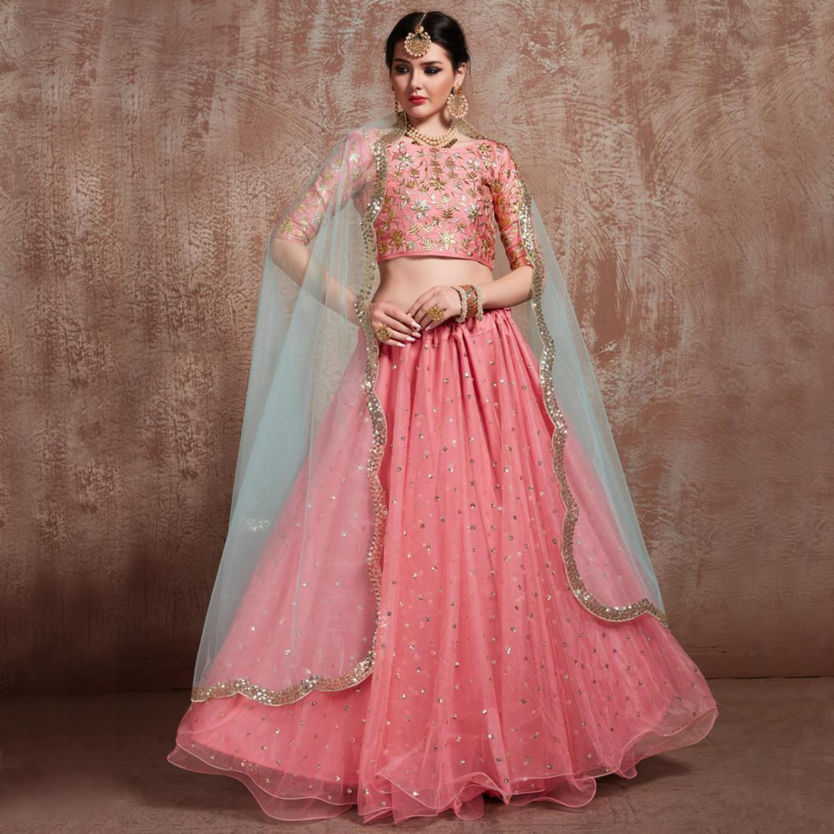 Sensational Pink Colored Partywear Embroidered Soft Net Lehenga Choli