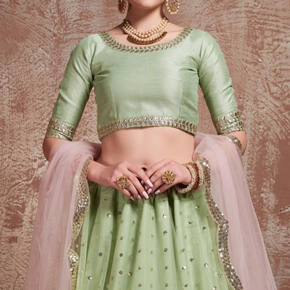 Stunning Mint Green Colored Partywear Embroidered Soft Net Lehenga Choli