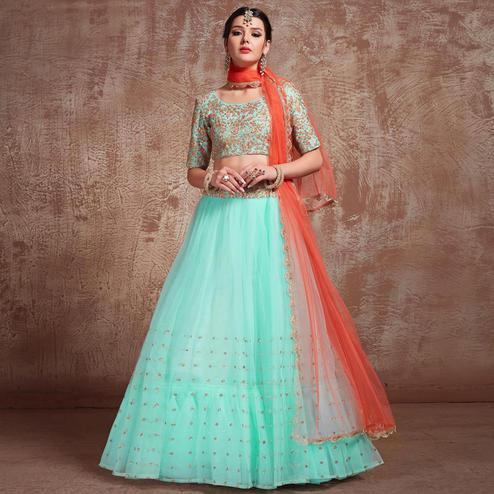 Flirty Aqua Blue Colored Partywear Embroidered Soft Net Lehenga Choli