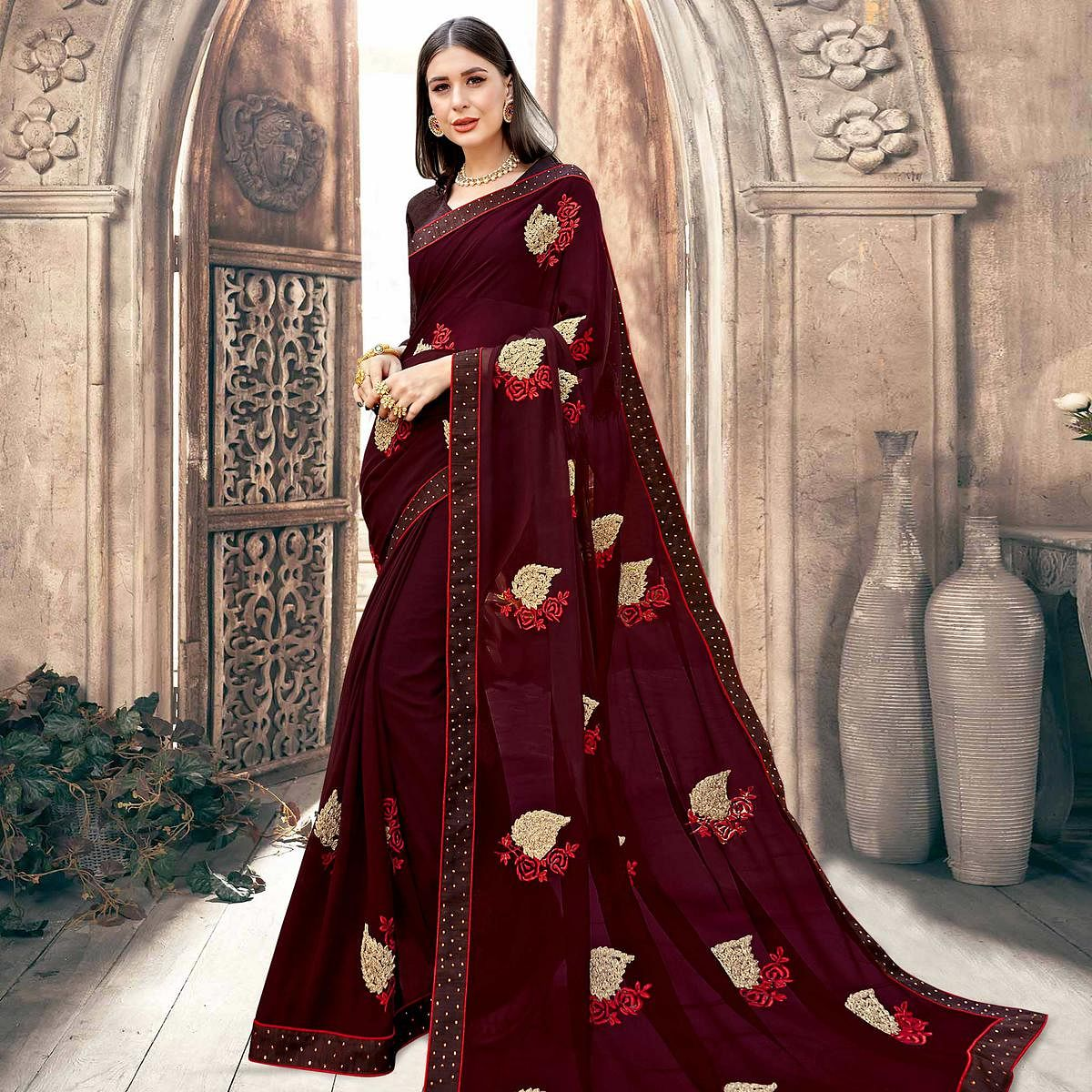 Pleasance Wine Colored Partywear Embroidered Georgette Saree