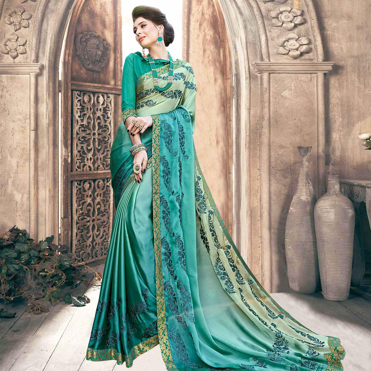 Surpassing Turquoise Green Colored Partywear Embroidered Georgette Saree