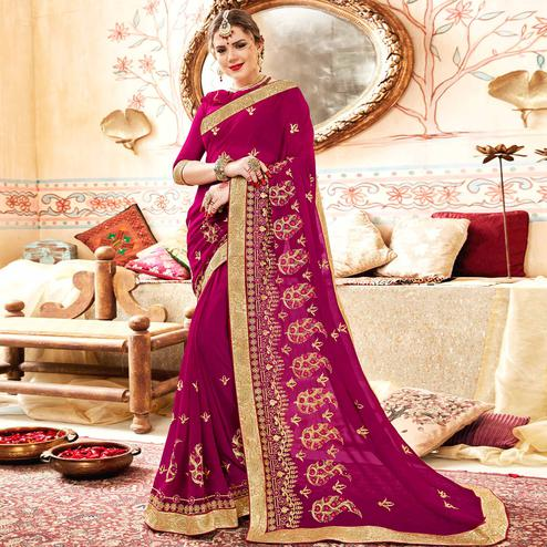Eye-catching Rani Pink Colored Partywear Embroidered Georgette Saree