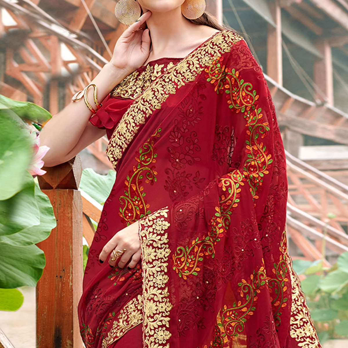 Entrancing Red Colored Partywear Embroidered Georgette Saree