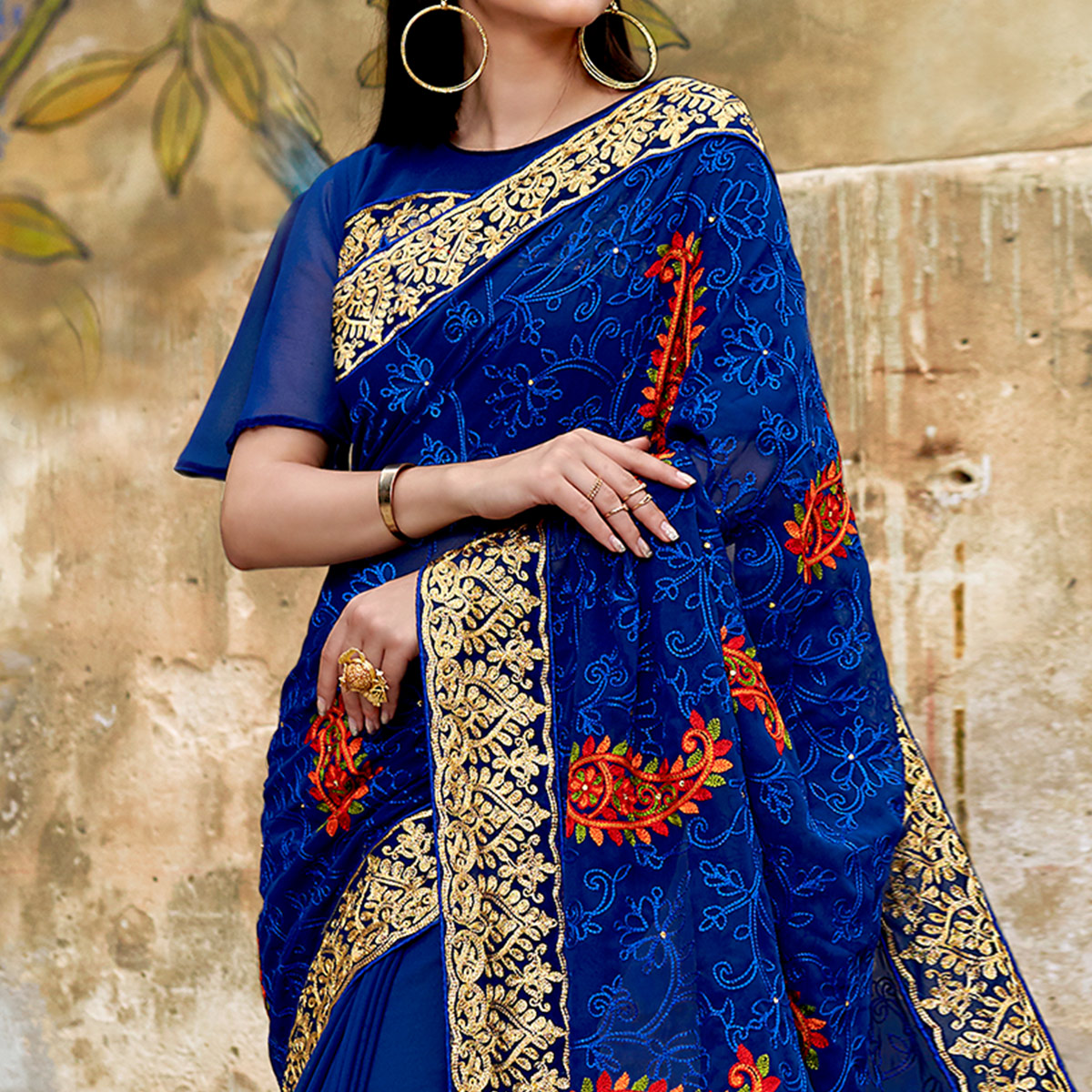 Capricious Blue Colored Partywear Embroidered Georgette Saree