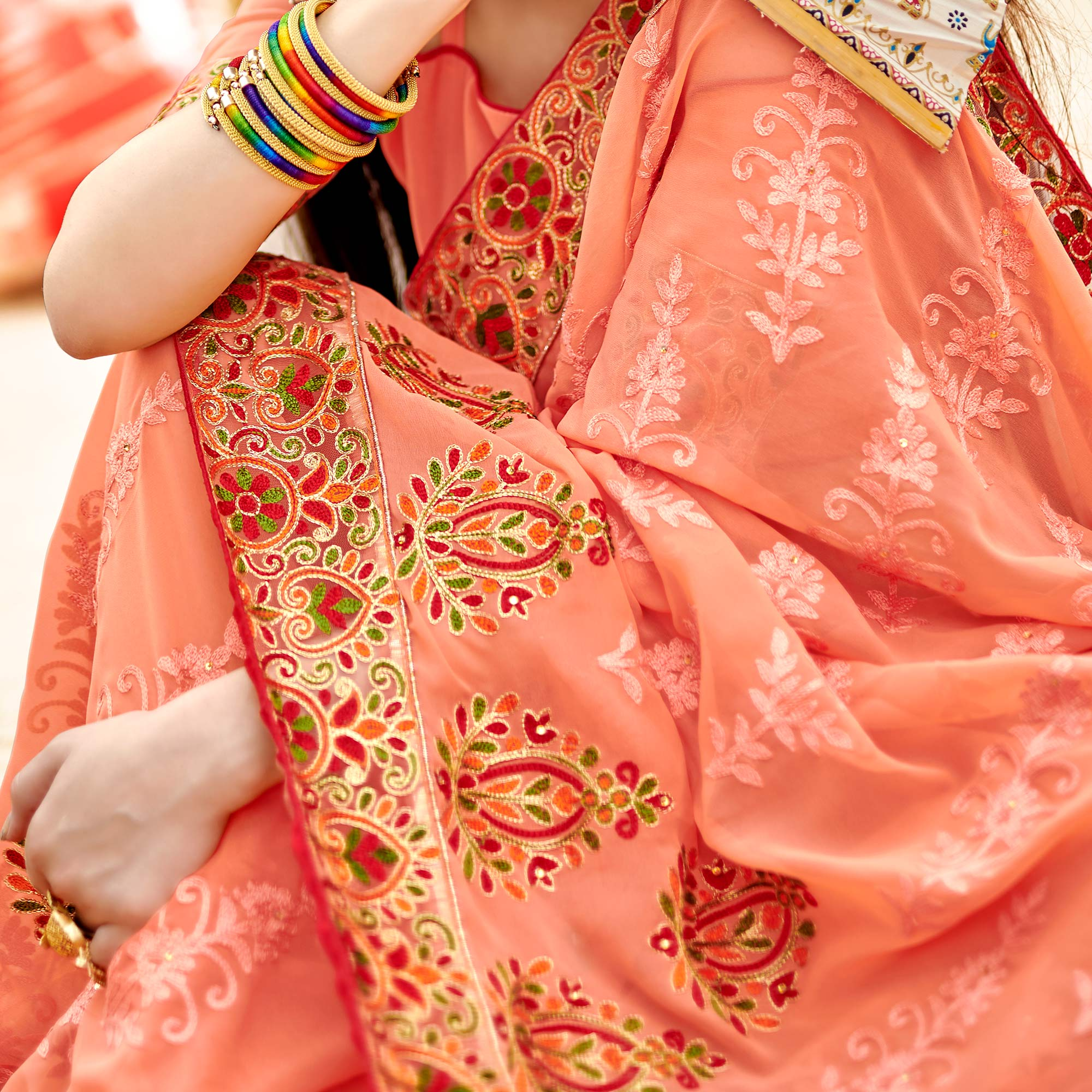 Appealing Peach Colored Partywear Embroidered Georgette Saree