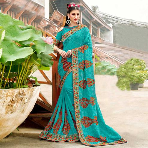 Classy Sky Blue Colored Partywear Embroidered Georgette Saree