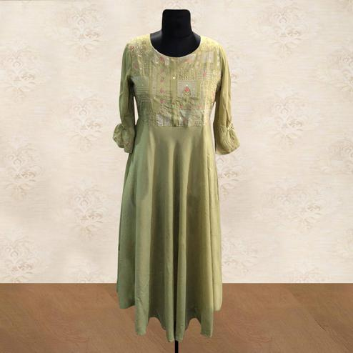 Hypnotic Green Colored Partywear Embroidered Cotton Kurti