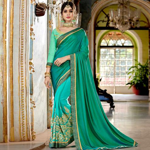 Lovely Turquoise Green Colored Partywear Embroidered Georgette Half-Half Saree