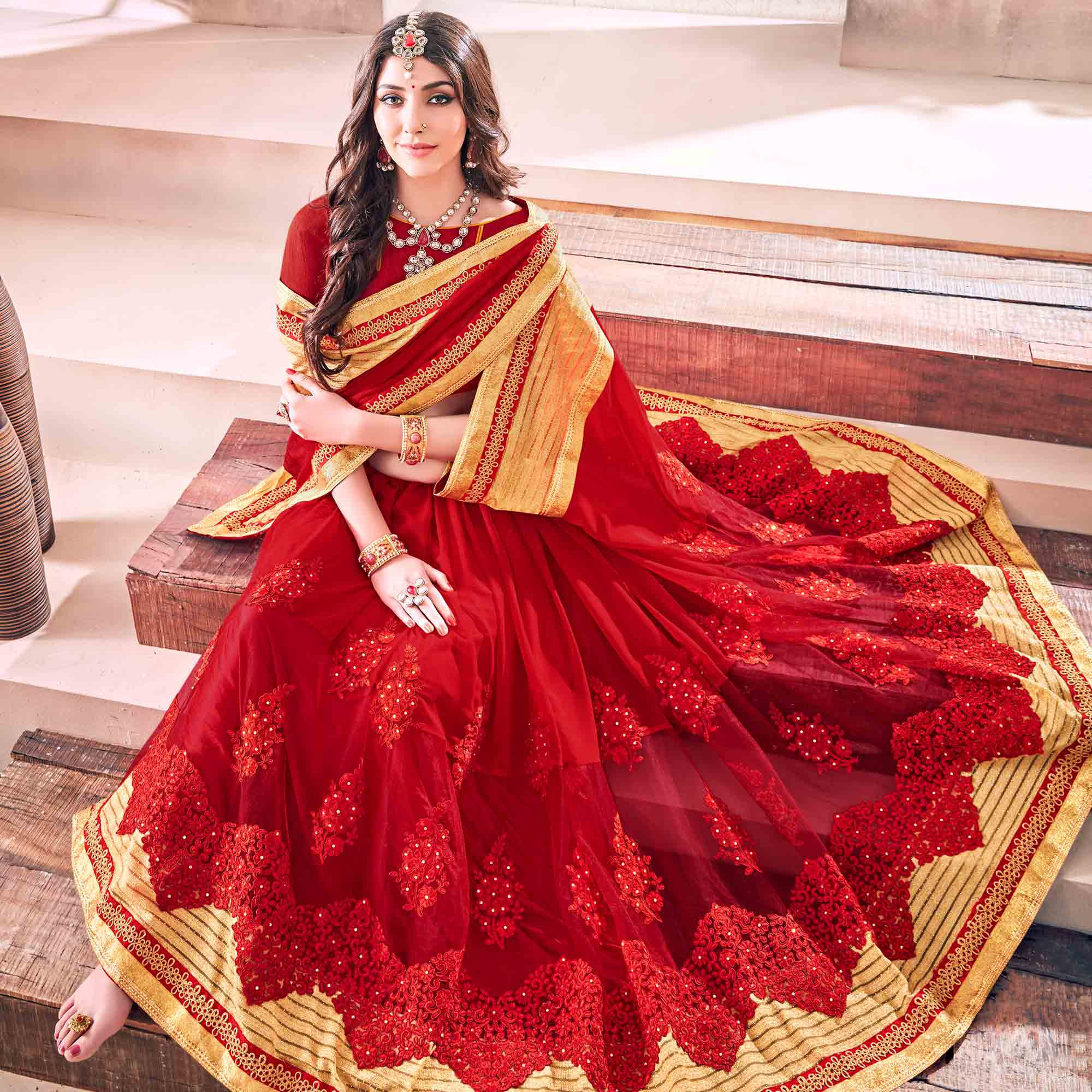 Exotic Red Colored Partywear Embroidered Georgette Saree