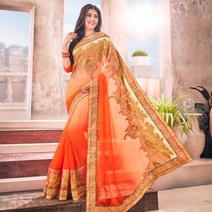 Trendy Orange Colored Partywear Embroidered Georgette Saree