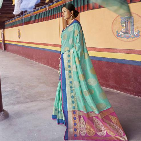 Capricious Aqua Green Colored Festive Wear Woven Art Silk Saree