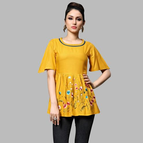 Surpassing Yellow Colored Partywear Embroidered Rayon Top