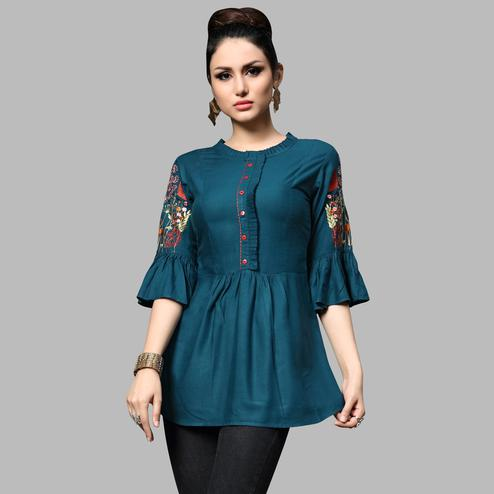 Staring Teal Blue Colored Partywear Embroidered Rayon Top