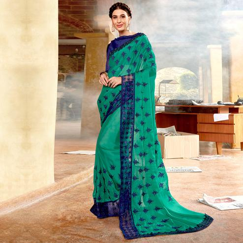 Radiant Aqua Green Colored Partywear Embroidered Georgette Saree