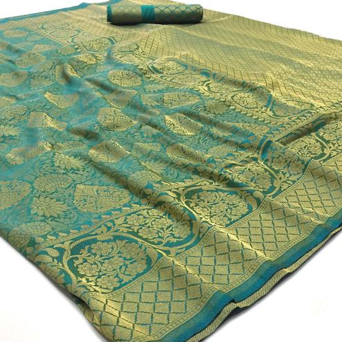 Gleaming Turquoise Blue Colored Festive Wear Woven Art Silk Saree