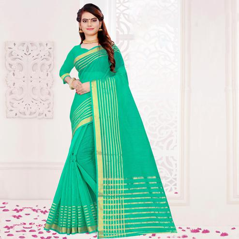 Pleasant Turquoise Green Colored Festive Wear Woven Cotton Saree