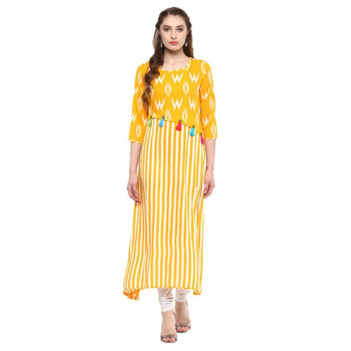 Prominent Yellow Colored Casual Printed Crepe Kurti