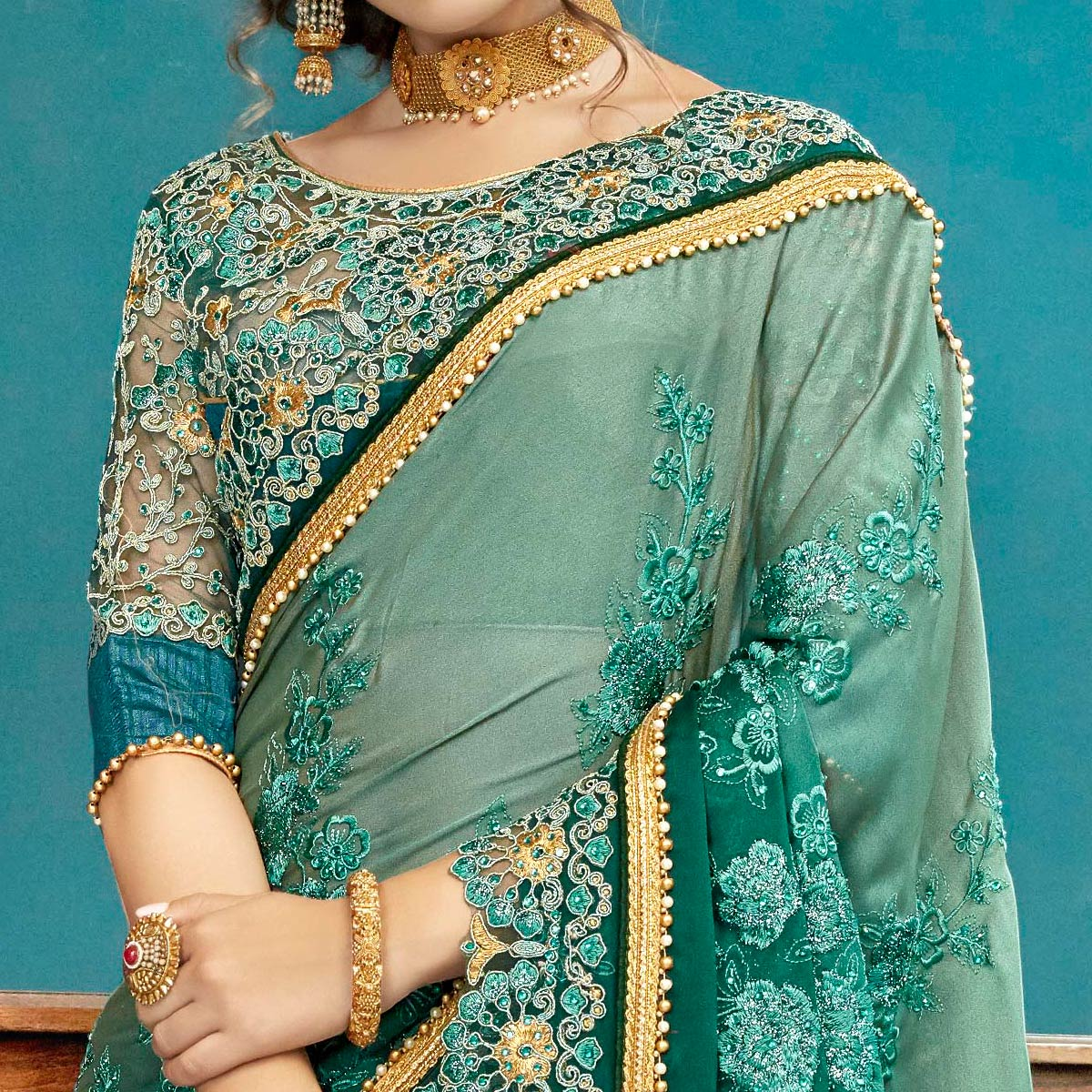 Adorning Teal Green Colored Partywear Embroidered Georgette Saree