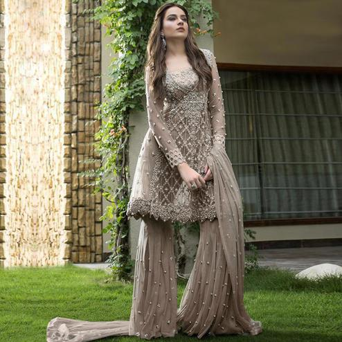 Capricious Grey Colored Partywear Embroidered Netted Palazzo Suit