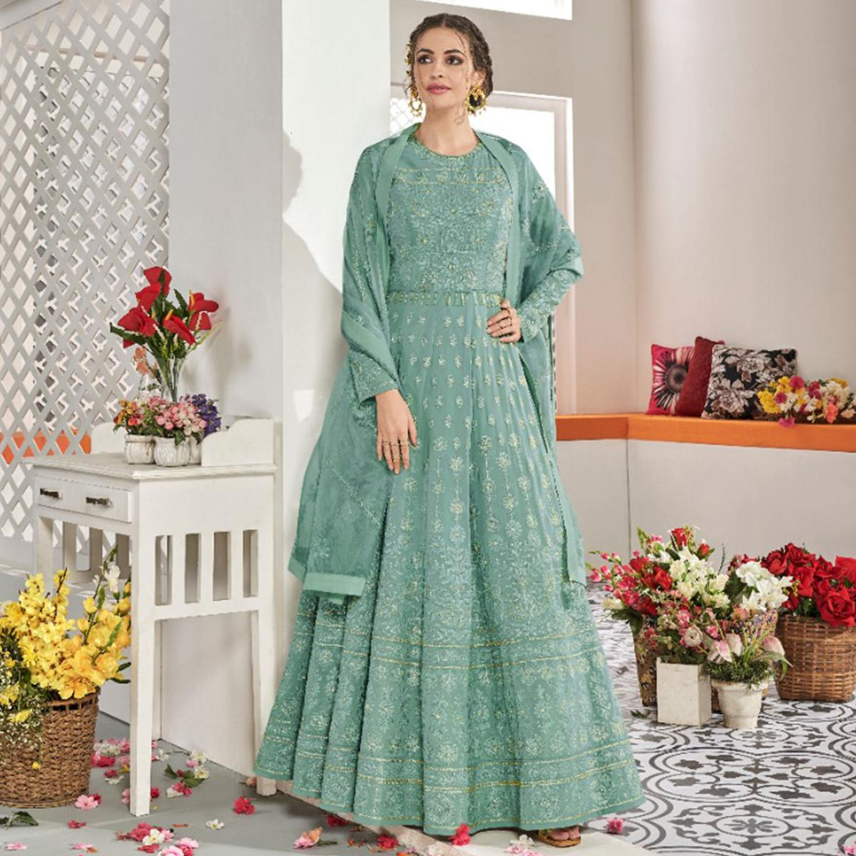Beautiful Aqua Green Colored Partywear Embroidered Georgette Anarkali Suit