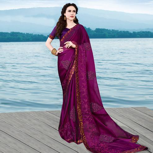 Adorning Dark Purple Colored Partywear Embroidered Georgette Saree