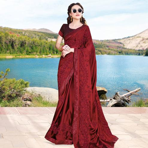 Capricious Maroon Colored Partywear Embroidered Georgette Saree