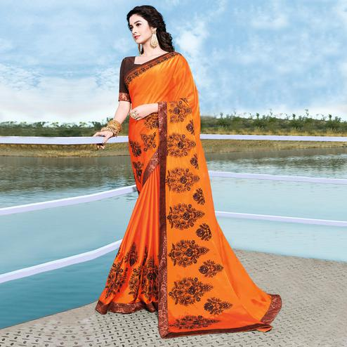 Prominent Dark Orange Colored Partywear Embroidered Georgette Saree