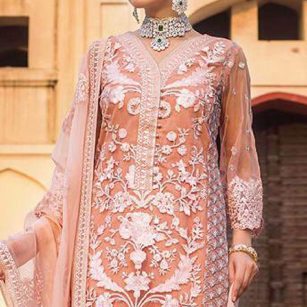 Prominent Peach Colored Partywear Embroidered Net-Georgette Pant Style Suit