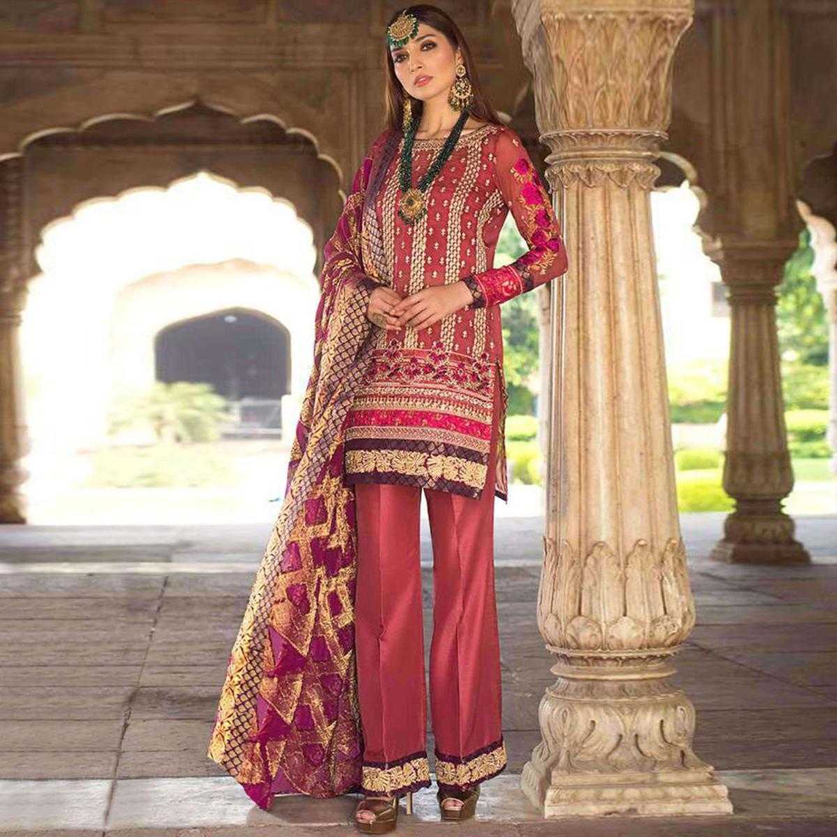 Capricious Red Colored Partywear Embroidered Net-Georgette Pant Style Suit