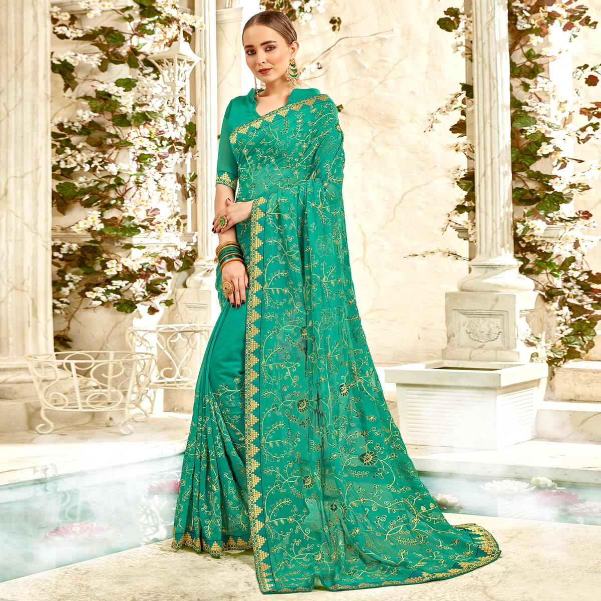 Hypnotic Turquoise Green Colored Partywear Embroidered Georgette Saree