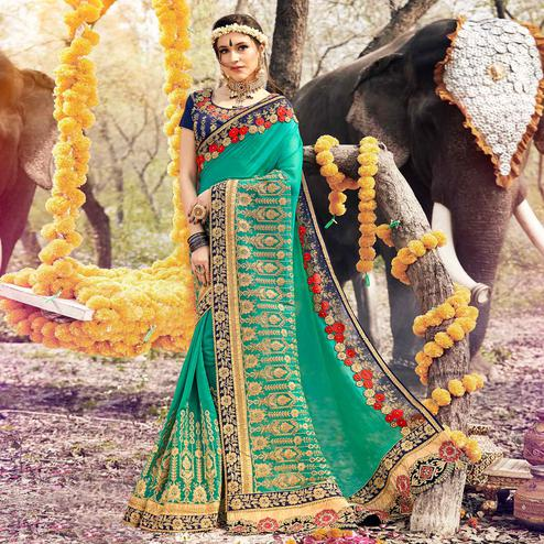 Adorning Turquoise Green Colored Party Wear Embroidered Georgette Saree