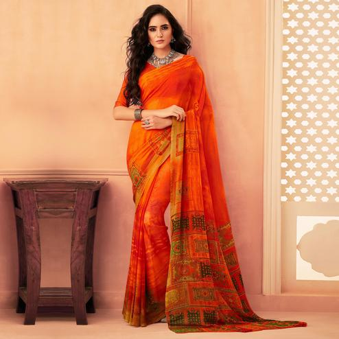 Exceptional Orange Colored Casual Wear Printed Georgette Saree