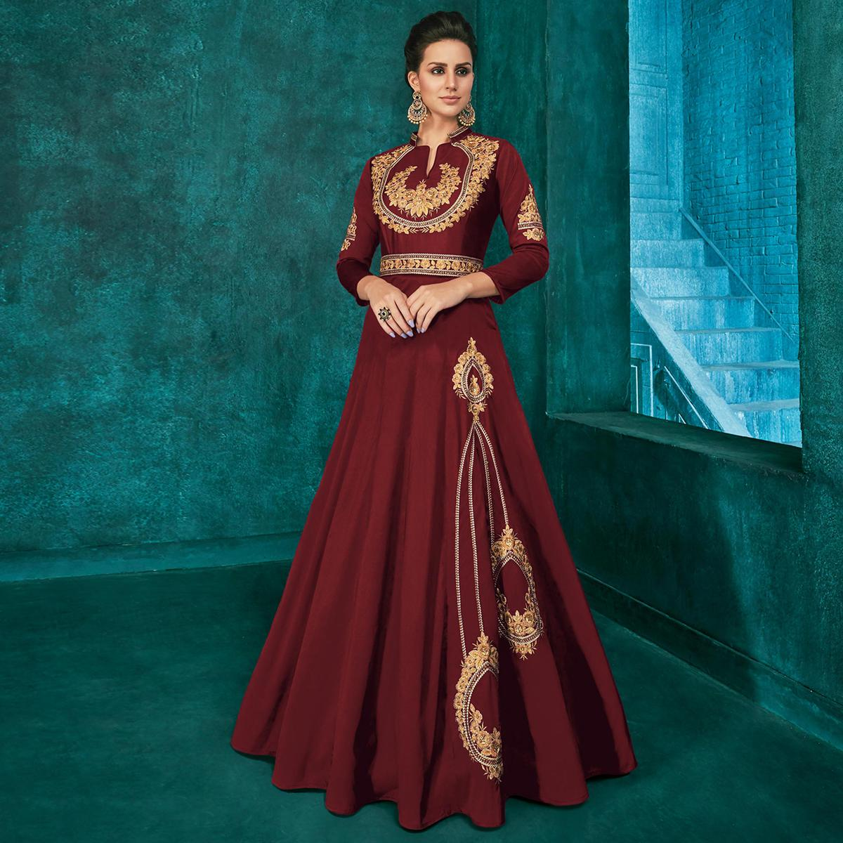 Appealing Maroon Colored Party Wear Embroidered Silk Gown