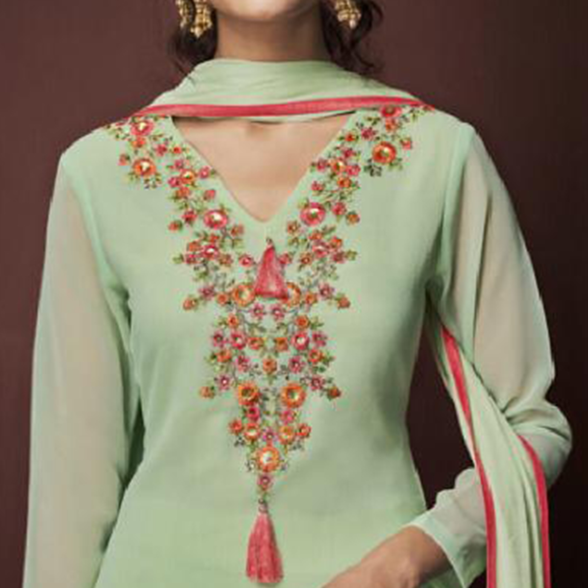 Capricious Pista Green Colored Partywear Embroidered Georgette Suit