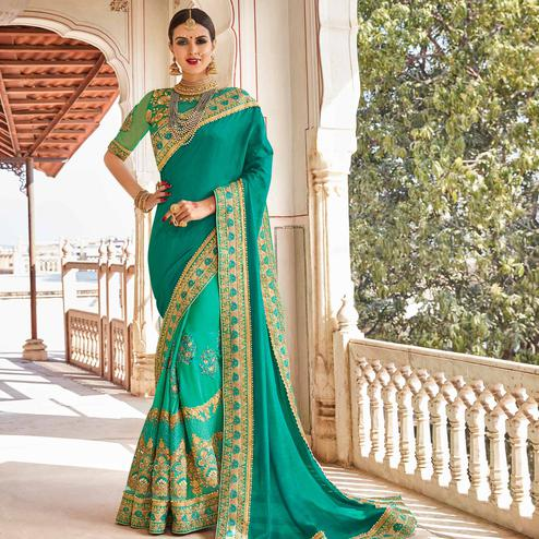 Mesmeric Turquoise Green Colored Party Wear Embroidered Georgette Saree