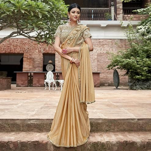 Breathtaking Beige Colored Partywear Embroidered Chiffon Saree