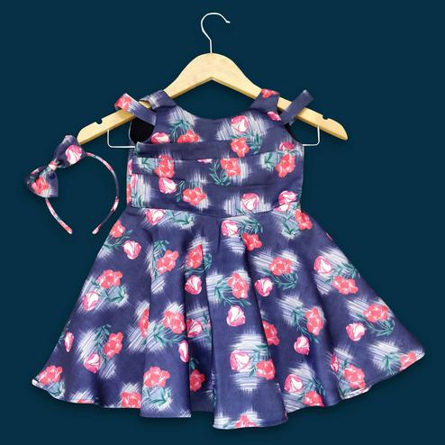 Glowing Navy Blue Colored Partywear Floral Printed Satin Frock